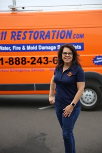 911-restoration-water-damage-mold-remediation-fire-damage-person-van-lady-pose