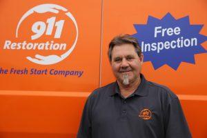 911-restoration-water-damage-mold-remediation-fire-damage-person-van-owner-background