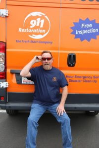 911-restoration-water-damage-mold-remediation-fire-damage-person-van-sunglasses