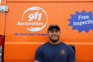 911-restoration-water-damage-mold-remediation-person-van